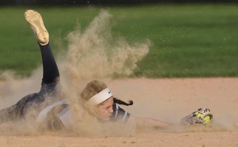 Glenbrook South shortstop Maddie Kapsimalis makes a diving catch of an infield fly ball during Tuesday's game against Glenbrook North.