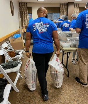 Ibraheem Oguntade, one of Islamic Relief's longtime supporters and champion volunteers, carries 50 pound bags of rice to refill any stations that are running low, all while fasting for Ramadan. The Naperville resident came early and stayed late to help as much as he could.