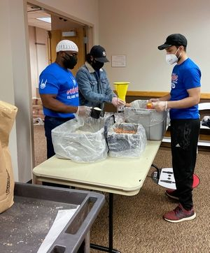 This group of volunteers packaged meals the quickest, sending baskets of meals at a time to the next station, all while fasting.