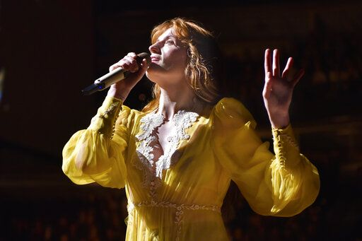 "FILE - Florence Welch of Florence + The Machine performs during ""The High As Hope Tour"" in Chicago on Oct 19, 2018. Welch is supplying the lyrics and co-writing music for a stage musical of 'œThe Great Gatsby,'� it was announced Wednesday. She will collaborate on the music with Thomas Bartlett. The story writer is Martyna Majok, who was awarded the 2018 Pulitzer Prize for Drama for 'œCost of Living.'� (Photo by Rob Grabowski/Invision/AP, File)"