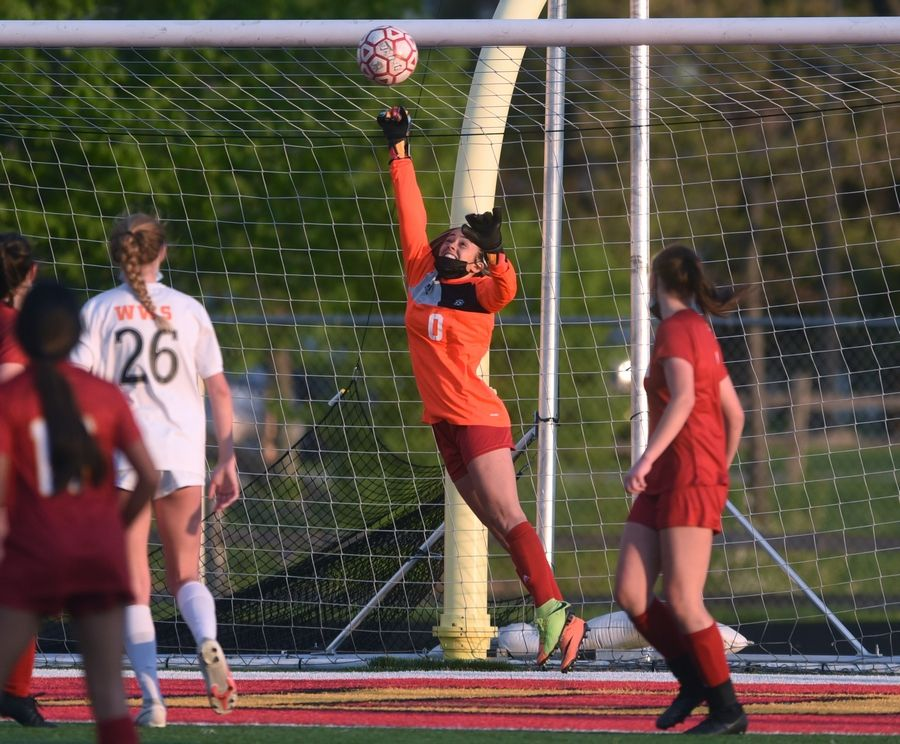 Batavia goalkeeper Morgan Haug (0) stretches to block a Wheaton Warrenville South kick but was unable to stop the ball from entering the net during Thursday's girls soccer game in Batavia.