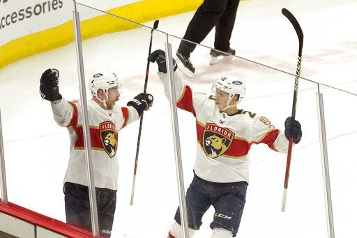 Florida Panthers Sam Bennett, left, celebrates his winning goal with Aleksi Heponiemi during the overtime period of an NHL hockey game against the Chicago Blackhawks, Thursday, April 29, 2021, in Chicago.