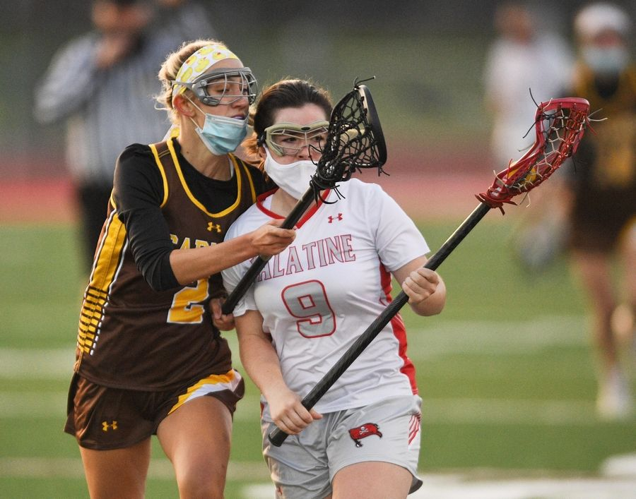 Palatine's Callie O'Connell is pressured by Carmel's Marie Giambrone in a girls lacrosse game in Palatine Friday, April 30, 2021.