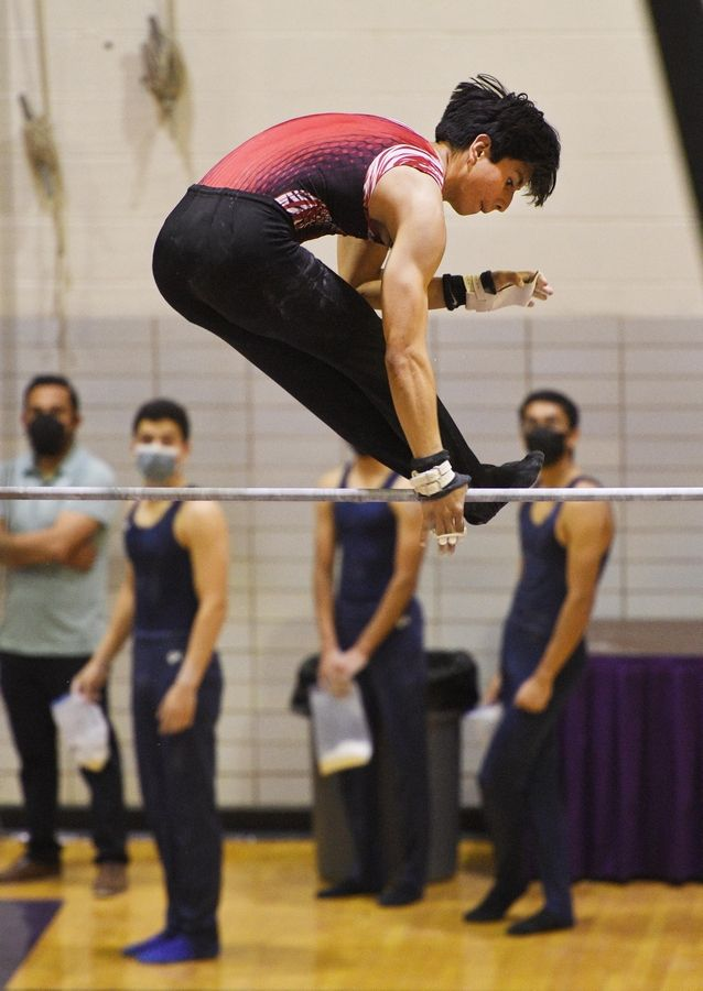 Glenbard East's Julian Raomn Reynah on the High Bar at the boys gymnastics sectional meet at Downers Grove North High School Monday, May 3, 2021.