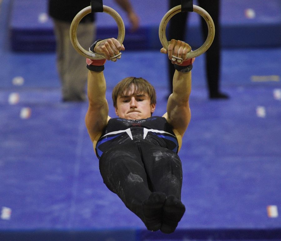 Wheaton Warrenville South's Andy Votava on the Still Rings at the boys gymnastics sectional meet at Downers Grove North High School Monday, May 3, 2021.