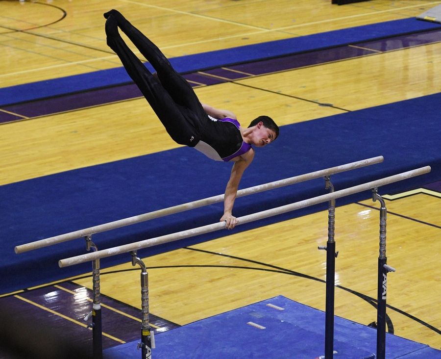 Downers Grove North's Anthony Nicholas on the Parallel Bars at the boys gymnastics sectional meet at Downers Grove North High School Monday, May 3, 2021.
