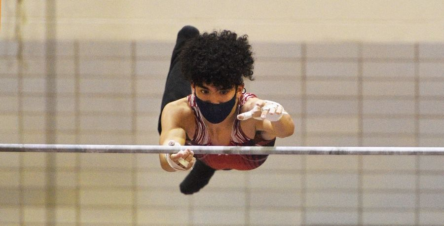 Glenbard East's Constantine Dialektakos on the High Bar at the boys gymnastics sectional meet at Downers Grove North High School Monday, May 3, 2021.