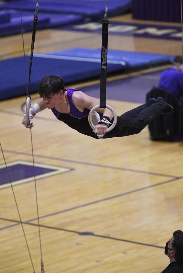 Downers Grove North's Parker Elisha on the Still Rings at the boys gymnastics sectional meet at Downers Grove North High School Monday, May 3, 2021.