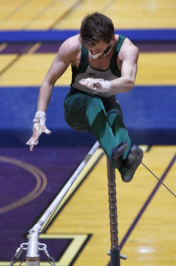 Elk Grove's Alex Wojtowicz on the High Bar at the boys gymnastics sectional meet at Downers Grove North High School Monday, May 3, 2021.