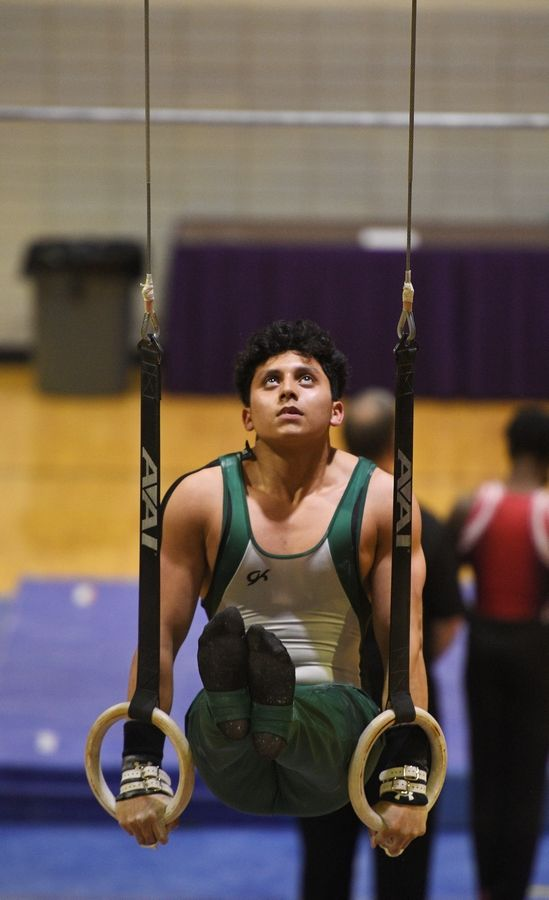 Elk Grove's Anthony Maya on the Still Rings at the boys gymnastics sectional meet at Downers Grove North High School Monday, May 3, 2021.