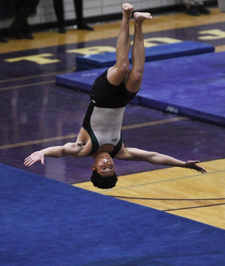 Elk Grove's Anthony Maya on the Floor Exercise at the boys gymnastics sectional meet at Downers Grove North High School Monday, May 3, 2021.