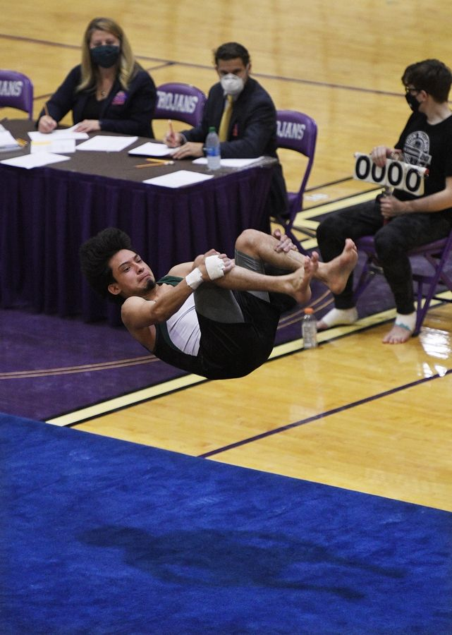Elk Grove's Edgar Vega on the Floor Exercise at the boys gymnastics sectional meet at Downers Grove North High School Monday, May 3, 2021.