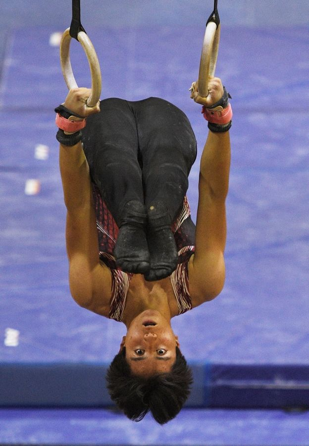 Glenbard East's Julian Raomn Reynah on the Still Rings at the boys gymnastics sectional meet at Downers Grove North High School Monday, May 3, 2021.
