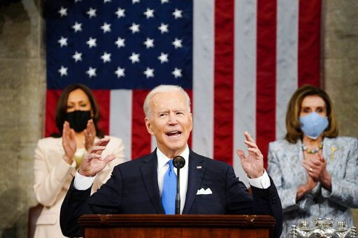 "FILE - In this Wednesday, April 28, 2021, file photo, U.S. President Joe Biden addresses a joint session of Congress in the House Chamber at the U.S. Capitol as Vice President Kamala Harris, left, and House Speaker Nancy Pelosi of Calif., applaud, in Washington. North Korea on Sunday, May 2, warned the United States will face ""a very grave situation"" because Biden ""made a big blunder"" in his recent speech by calling the North a security threat and revealing his intent to maintain a hostile policy toward it. (Melina Mara/Pool Photo via AP, File)"