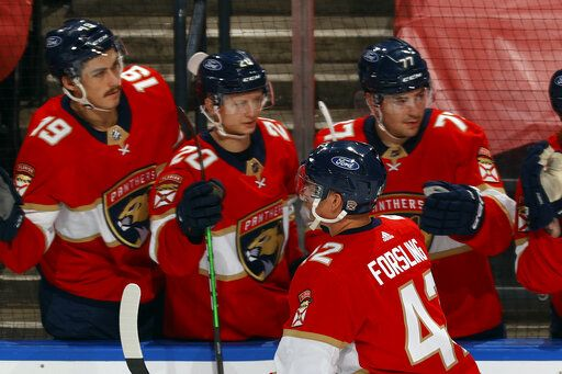 Teammates congratulate Florida Panthers defenseman Gustav Forsling (42) after he scored a goal against the Dallas Stars during the second period of an NHL hockey game, Monday, May 3, 2021, in Sunrise, Fla.
