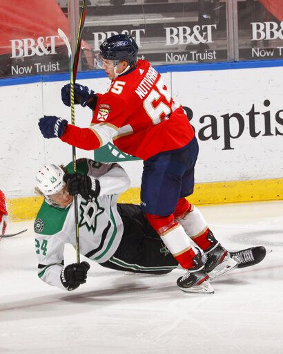 Florida Panthers defenseman Markus Nutivaara (65) takes Dallas Stars left wing Roope Hintz (24) to the ice during the second period of an NHL hockey game, Monday, May 3, 2021, in Sunrise, Fla.