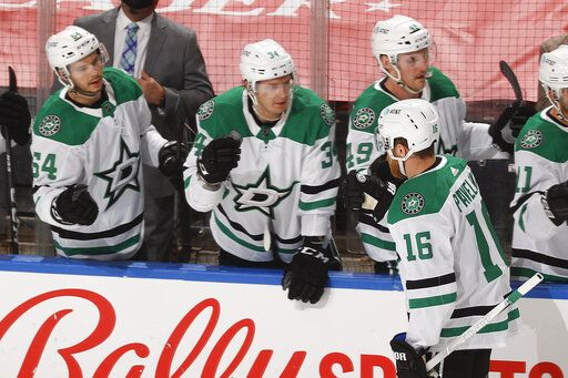 Teammates congratulate Dallas Stars center Joe Pavelski (16) after he scored a goal against the Florida Panthers during the first period of an NHL hockey game, Monday, May 3, 2021, in Sunrise, Fla.
