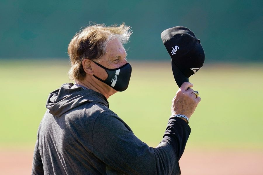 Chicago White Sox manager Tony LaRussa waves his cap as he talks to someone during a spring training baseball practice Wednesday, Feb. 24, 2021, in Phoenix.