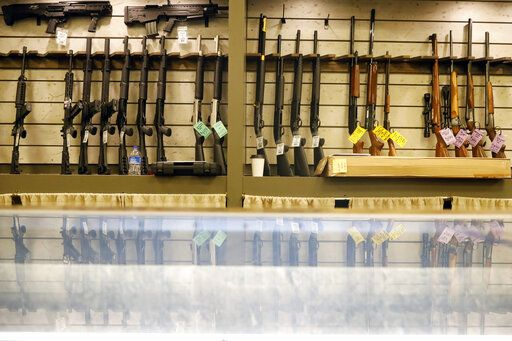 Guns are displayed in the showroom of Maxon Shooter's Supplies and Indoor Range, Friday, April 30, 2021, in Des Plaines, Ill. After a year of pandemic lockdowns, mass shootings are back, but the guns never went away. As the U.S. inches toward a post-pandemic future, guns are arguably more present in the American psyche and more deeply embedded in American discourse than ever before. The past year's anxiety and loss fueled a rise in gun ownership across political and socio-economic lines.