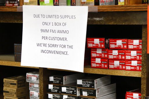 FILE - In this Wednesday, March 25, 2020, file photo, signs point out quantity limits on certain types of ammunition after Dukes Sport Shop reopened, in New Castle, Pa. After a year of pandemic lockdowns, mass shootings are back, but the guns never went away. As the U.S. inches toward a post-pandemic future, guns are arguably more present in the American psyche and more deeply embedded in American discourse than ever before. The past year's anxiety and loss fueled a rise in gun ownership across political and socio-economic lines.