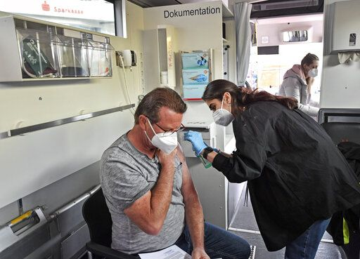 Harald Fischer gets a Moderna vaccination in a vaccination mobile on a square at the district  Chorweiler in Cologne, Germany, Monday, May 3, 2021. The city of Cologne started a program to bring COVID-19 vaccination to people living in this neighborhood with a high corona incidence.