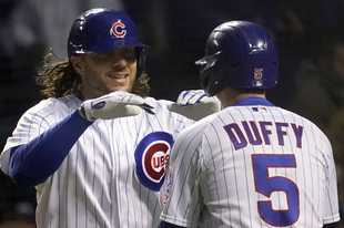 Chicago Cubs' Jake Marisnick, left, celebrates with Chicago Cubs' Matt Duffy after his two-run home run during the fifth inning of a baseball game against the Los Angeles Dodgers in Chicago, Wednesday, May 5, 2021. (AP Photo/Nam Y. Huh)