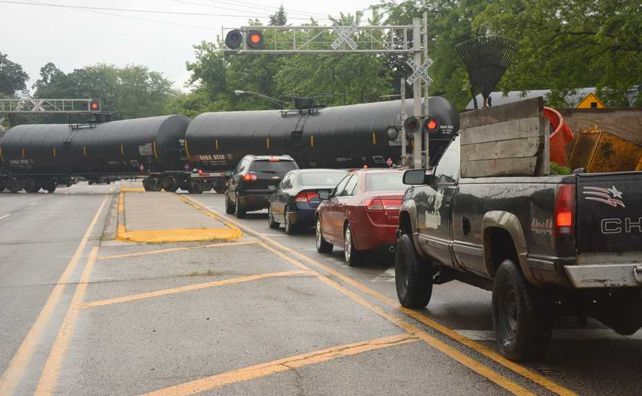 Cars wait for a freight train to pass on Route 14 in Barrington.
