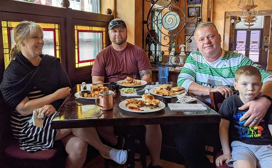 Peggy Kinnane's Irish Restaurant & Pub owners Michelle and Derek Hanley usher in Illinois' Bridge Phase Friday with lunch at their own downtown Arlington Heights business with son Conor and grandson Jack.