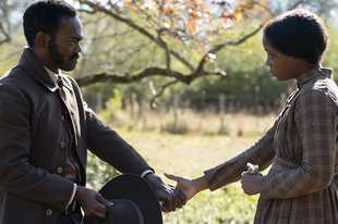 "Thuso Mbedu, right, plays Cora and William Jackson Harper is Royal in ""The Underground Railroad"" streaming on Amazon."
