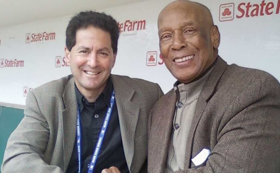 Barry Rozner with Cubs legend Ernie Banks in the dugout at Wrigley Field.