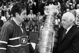 It was May 18, 1971, when Montreal captain Jean Beliveau is presented the Stanley Cup by NHL Commissioner Clarence Campbell after the Canadiens beat the Blackhawks 3-2 in Game 7 at the Stadium.