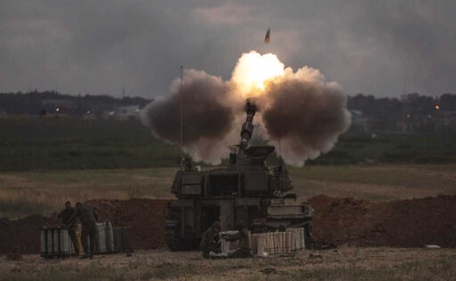 An Israeli artillery unit fires toward targets in the Gaza Strip, at the Israeli Gaza border, Monday, May 17, 2021. (AP Photo/Heidi Levine)