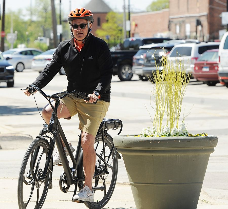 The City Commuter, black edition is one of the hottest-selling Pedego electric bikes at the new dealership in downtown Wheaton. Owner Jeff Alvis has a little fun on his as he rides around the shop on Liberty Drive.