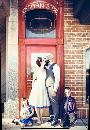 Wedding parties celebrate in front of the Little Popcorn Store in Wheaton.