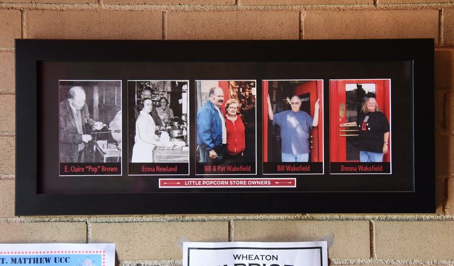 Photos of current and past owners of the Little Popcorn Store hang on the wall of the downtown Wheaton icon.