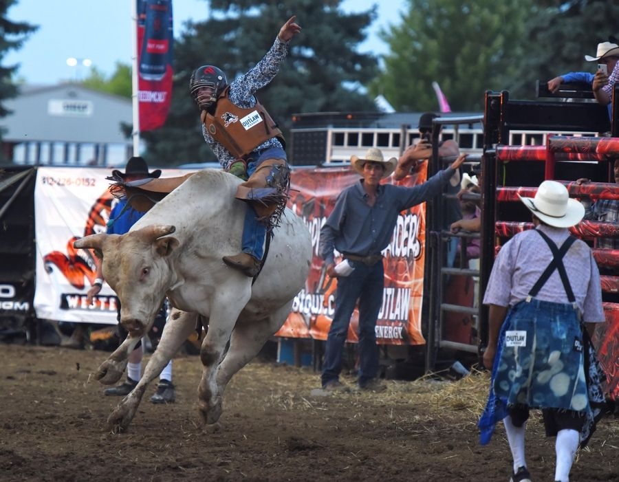 Bull Rider Cash Bronson competes at the 2019 Professional Championship Bull Riders Outlaw Energy Invitational at the Kane County Fair in St. Charles.
