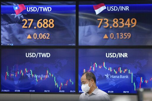 A currency trader watches monitors at the foreign exchange dealing room of the KEB Hana Bank headquarters in Seoul, South Korea, Thursday, Sept. 23, 2021. Asian shares were mostly higher on Thursday after the Federal Reserve signaled it may begin easing its extraordinary support measures for the economy later this year.