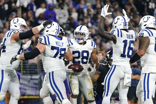 Indianapolis Colts running back Jonathan Taylor (28) celebrates his touchdown with his teammates during the second half of an NFL football game against the Baltimore Ravens, Monday, Oct. 11, 2021, in Baltimore.