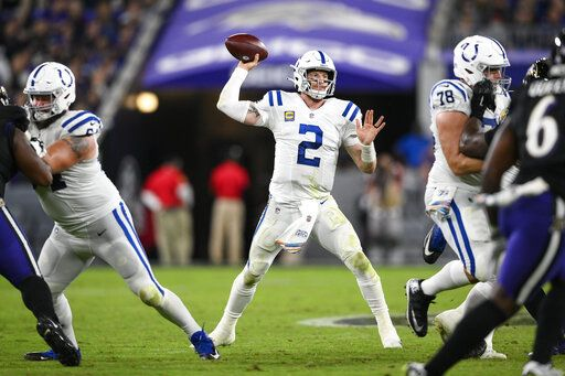 Indianapolis Colts quarterback Carson Wentz (2) throws the ball during the second half of an NFL football game against the Baltimore Ravens, Monday, Oct. 11, 2021, in Baltimore.
