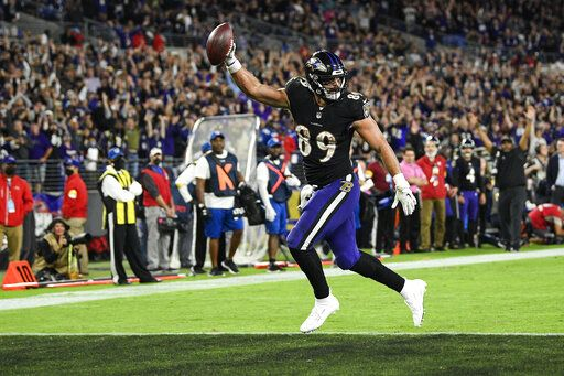 Baltimore Ravens tight end Mark Andrews (89) scores on a two-point conversion during the second half of an NFL football game against the Indianapolis Colts, Monday, Oct. 11, 2021, in Baltimore.