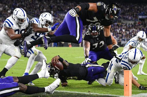 Baltimore Ravens quarterback Lamar Jackson (8) stretches for a failed attempt for a 2-point conversion during the second half of an NFL football game against the Indianapolis Colts, Monday, Oct. 11, 2021, in Baltimore.