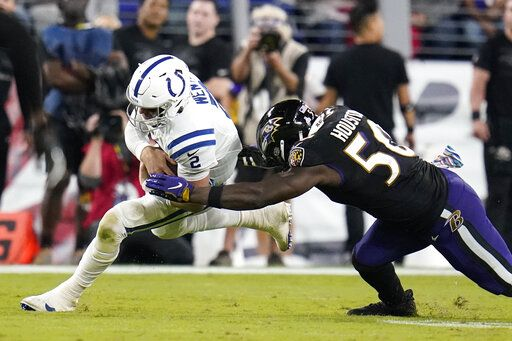 Indianapolis Colts quarterback Carson Wentz (2) is hit by Baltimore Ravens outside linebacker Justin Houston (50) during the second half of an NFL football game Monday, Oct. 11, 2021, in Baltimore.
