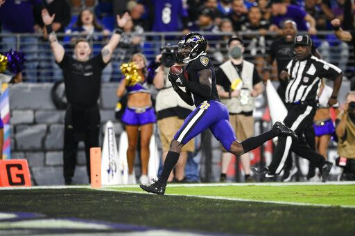 Baltimore Ravens wide receiver Marquise Brown, center, scores a touchdown during the second half of an NFL football game against the Indianapolis Colts, Monday, Oct. 11, 2021, in Baltimore.