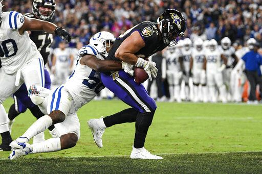 Baltimore Ravens tight end Mark Andrews (89) scores on the two-point conversion in front of Indianapolis Colts middle linebacker Bobby Okereke (58) during the second half of an NFL football game Monday, Oct. 11, 2021, in Baltimore.