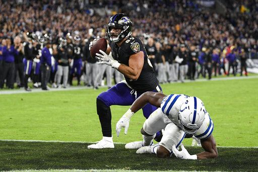Baltimore Ravens tight end Mark Andrews (89) stands after his touchdown in front of Indianapolis Colts middle linebacker Bobby Okereke (58) during the second half of an NFL football game Monday, Oct. 11, 2021, in Baltimore.