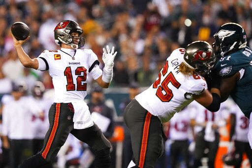 Tampa Bay Buccaneers quarterback Tom Brady (12) is looking to pass the first half of the NFL football game against the Philadelphia Eagles on Thursday, October 14, 2021, in Philadelphia.