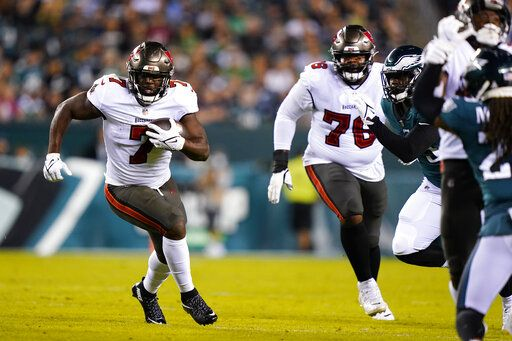 Philadelphia Eagles quarterback Jalen Hurts (1) appears to pass under pressure from the Tampa Bay Buccaneers, except for centerback Shaquil Barrett (58) during the first half of the NFL football game played in Philadelphia on Thursday, October 14, 2021.