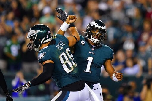 Philadelphia Eagles quarterback Jalen Hurts (1) celebrates Philadelphia Eagles contact with tight end Zach Ertz (86) in the second half of an NFL football game with the Tampa Bay Buccaneers on Thursday, October 14, 2021, in Philadelphia.