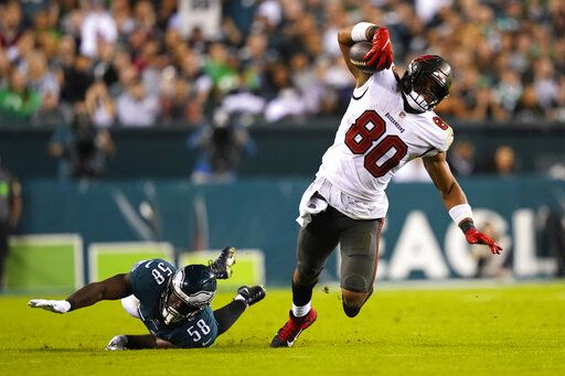 Tampa Bay Buccaneers tight end OJ Howard (80) was stopped by the Philadelphia Eagles outside of defender Genard Avery (58) during the second half of an NFL football game in Philadelphia on Thursday, October 14, 2021.