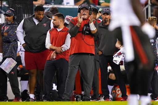 Tampa Bay Buccaneers head coach Bruce Arians applauds in the first half of the NFL football game against the Philadelphia Eagles on Thursday, October 14, 2021, in Philadelphia.